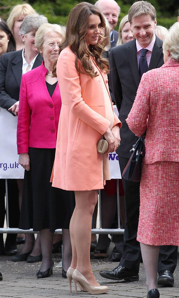 Kate Middleton dresses her baby bump in a Tara Jarmon coat to visit the Naomi House Hospice