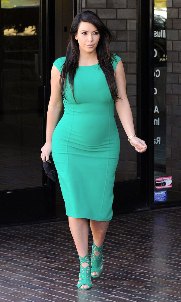 Kim Kardashian's continues pregnancy style in figure-hugging green dress