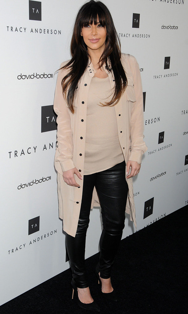 Pregnant Kim Kardashian nails maternity chic in leather trousers