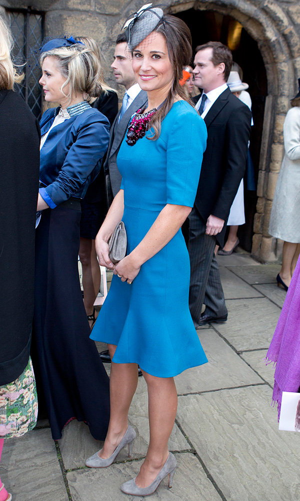 Pippa Middleton shows off her wedding guest style in regal blue dress