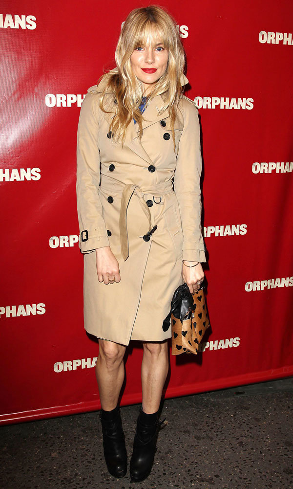 Sienna Miller rocks bright red lips and classic trench to support Tom Sturridge in Orphans play