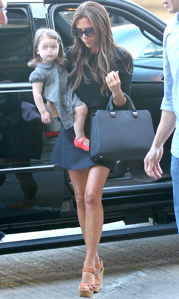 Victoria and Harper Beckham show off their airport style