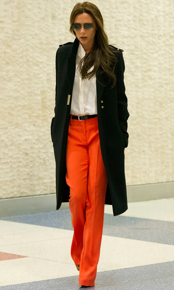 Victoria Beckham embraces colour in tangerine trousers
