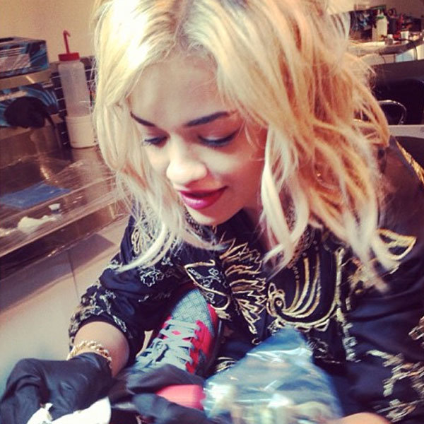 Rita Ora turns tattoo artist