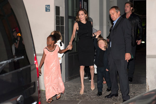 Angelina Jolie and Brad Pitt head out for a birthday dinner - with all six children in tow!