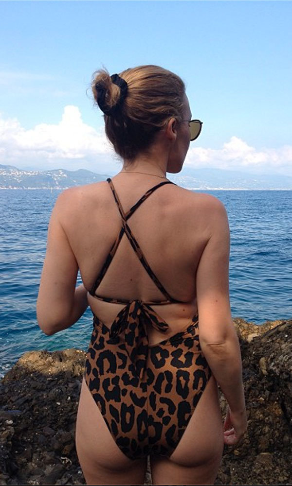 Kylie Minogue wows in leopard print swimsuit