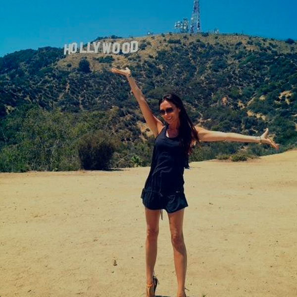 Victoria Beckham swaps trademark heels for flats as she hits the Hollywood hills