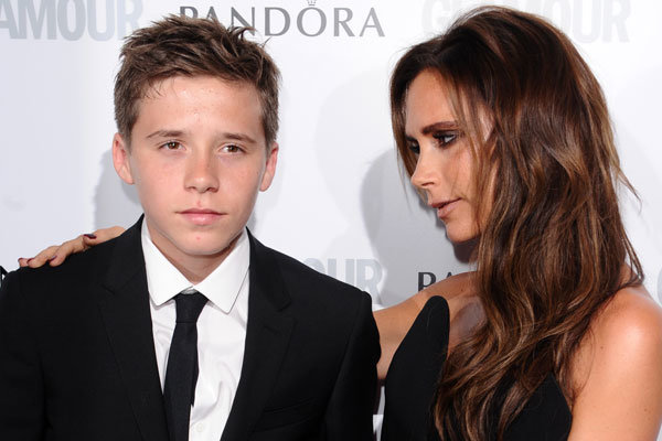 Victoria Beckham helicopters in to Brooklyn's parents' evening
