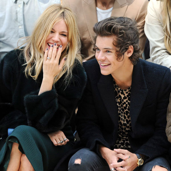 Sienna Miller And Harry Styles Cosy Up At Burberry Spring Summer 2014