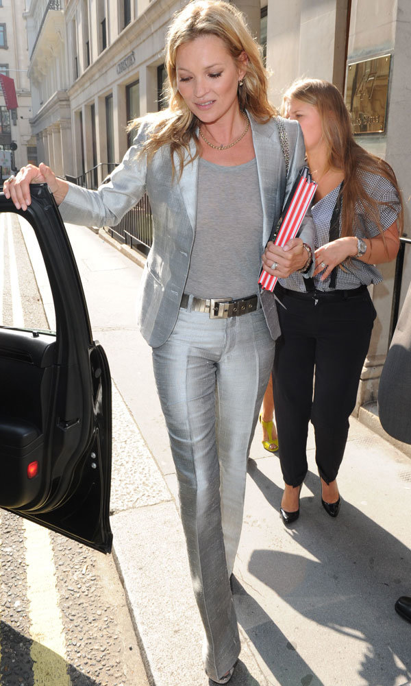 Kate Moss shines in silver at Christies