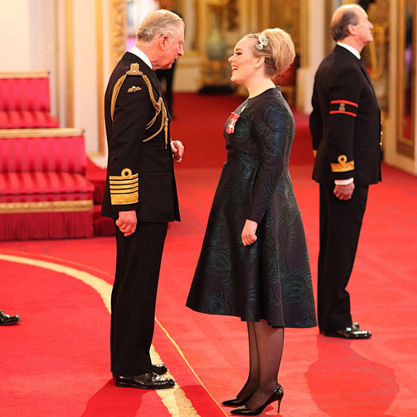 Adele Bursts Into Fits Of Giggles As She Accepts Her MBE At Buckingham Palace