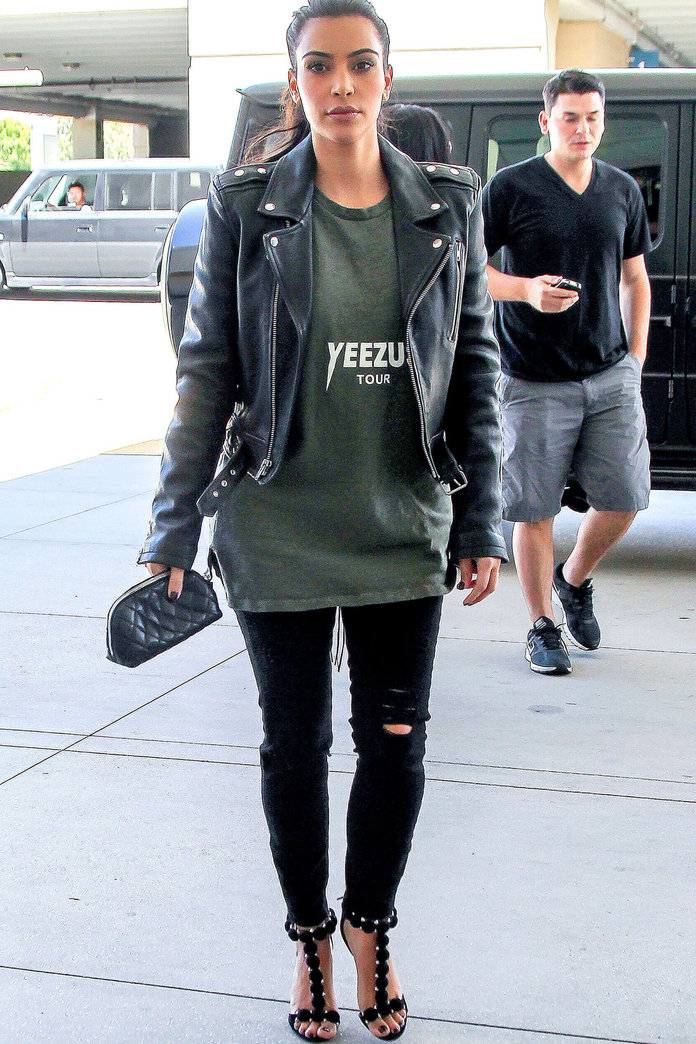 Kim Kardashian Wears Kanye's Shirt As She Changes Her Name To West