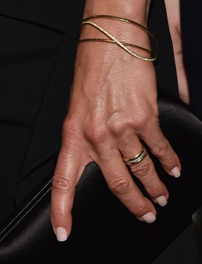 made of two gold bands with a channel of diamonds sandwiched between them we couldnt imagine a more jen choice classic striking but not too showy - Jennifer Aniston Wedding Ring
