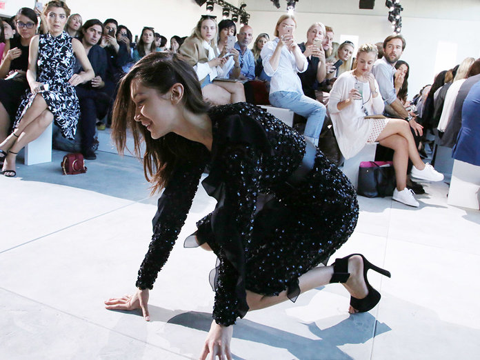WATCH: Bella Hadid Fell At NYFW (And Dealt With It In The Best Way Possible)