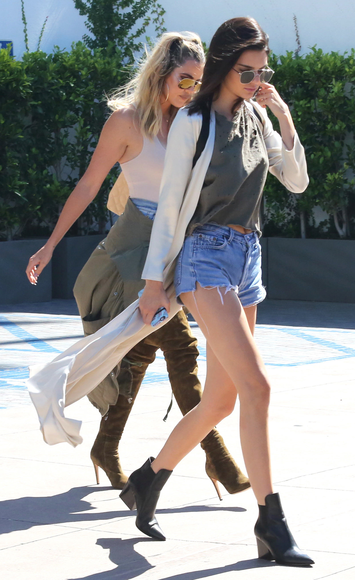 Monday, July 18, 2016 - Kendall Jenner and Khloe Kardashian leave a filming at Mr. C Beverly Hills hotel in Kendall's brand new Mercedes McLaren and goe to a medical building in Beverly Hills, CA. Kendall wears a distressed green midriff top and blue jean
