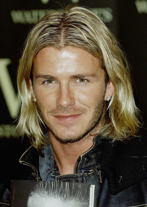 LONDON - NOVEMBER 17: Footballer David Beckham signs copies of his autobiography  My Side  at Waterstone's Piccadilly, on November 17, 2003 in London. (Photo by Steve Finn/Getty Images)