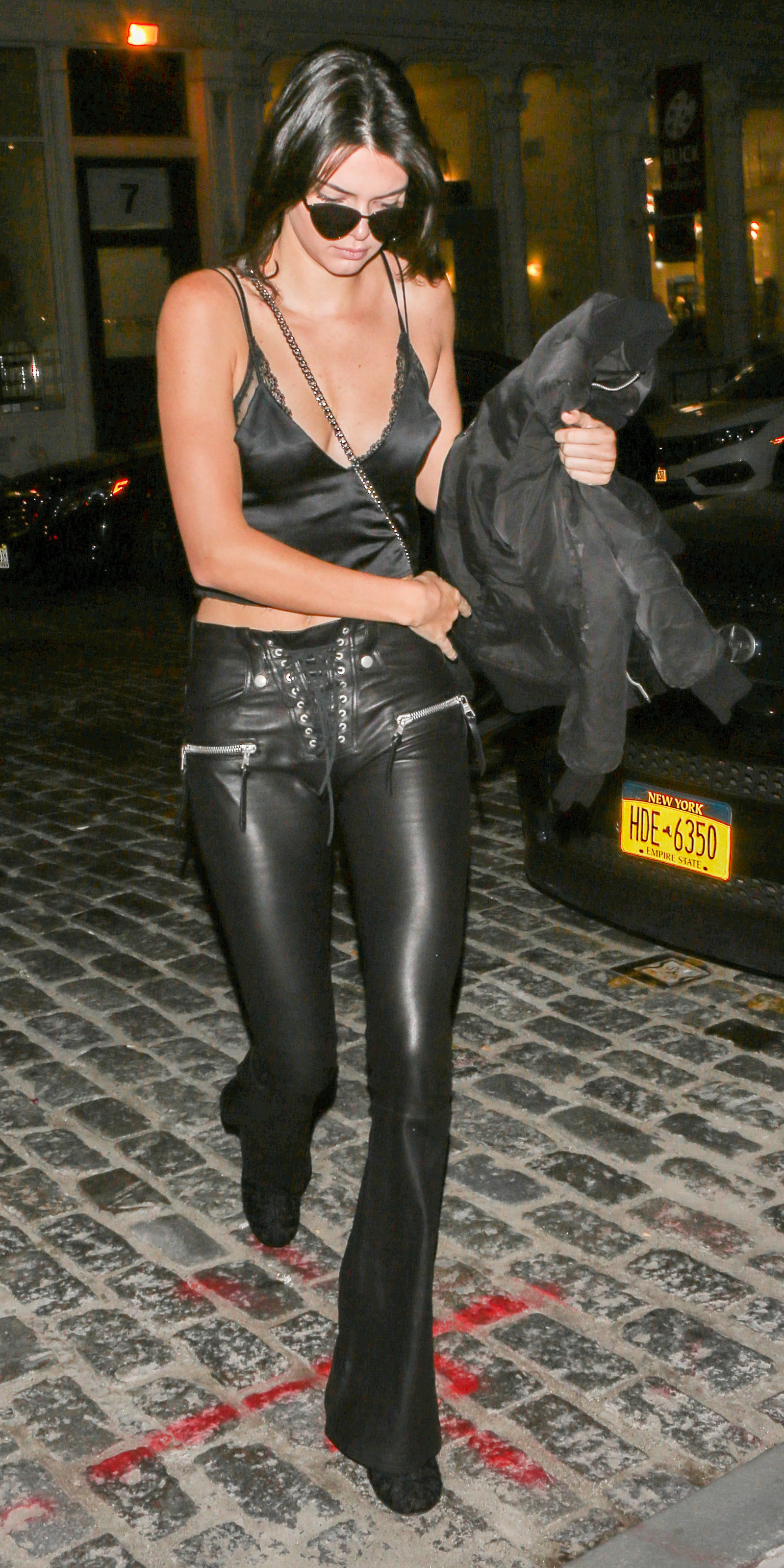September 13, 2016: Kendall Jenner is seen with a lingerie top and leather pants as she arrives at Gigi Hadid apartment in New York City. Mandatory Credit: PapJuice/INFphoto.com Ref.: infusny-286