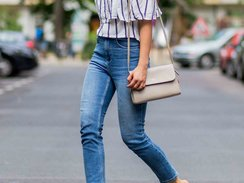 BERLIN, GERMANY -  MAY 29: Miriam Mache wearing a white navy striped off shoulder shirt from Zara, a Radley London bag, blue BDG denim jeans, Rodenstock sunglasses and black JustFab heels on May 29, 2016 in Berlin, Germany. (Photo by Christian Vierig)