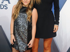 Actresses Maisy Stella and Lennon Stella attend the 49th annual CMA Awards at the Bridgestone Arena on November 4, 2015 in Nashville, Tennessee.