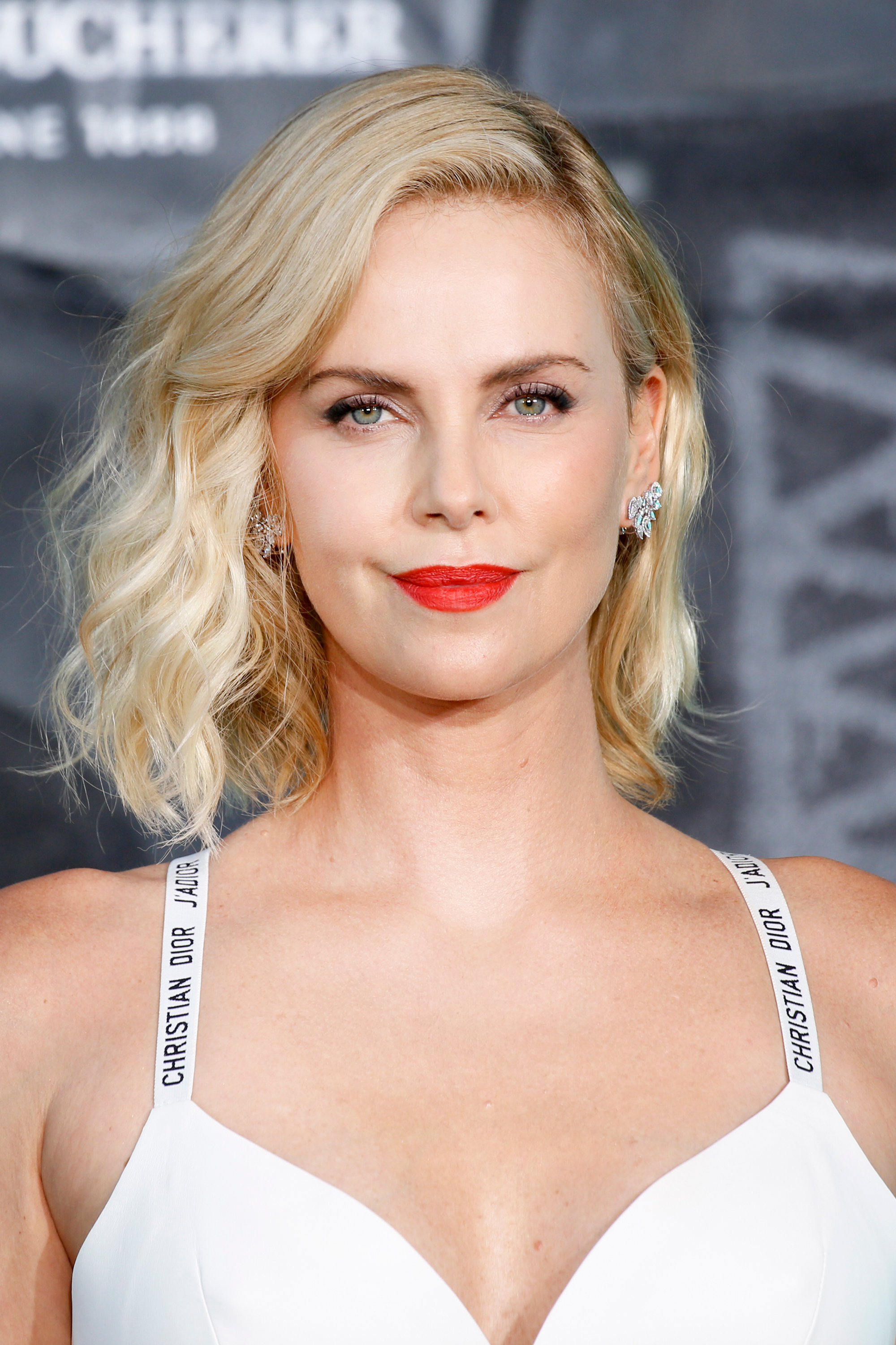 charlize theron plays with the 'atomic blonde' snapchat lens